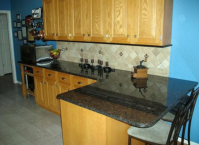 Granite is a great option when kitchen remodeling - @Flickr / granite-charlotte